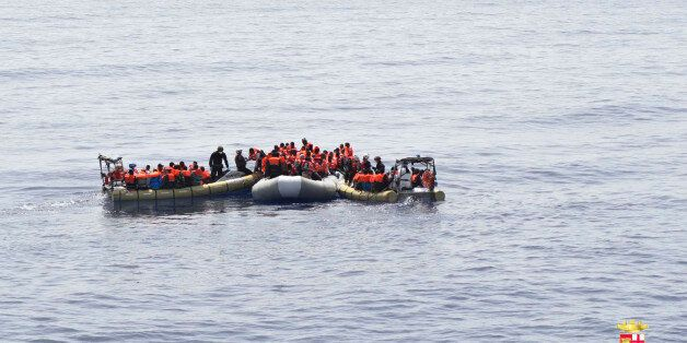 This undated image made available Monday, May 30, 2016 by the Italian Navy Marina Militare shows migrants...