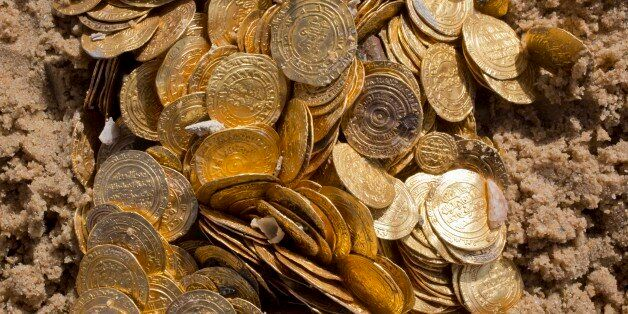 This photo shows a detail of Fatimid period gold coins that were found in the seabed in the Mediterranean...