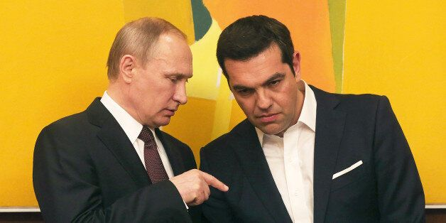 Greek Prime Minister Alexis Tsipras , right, chats with Russian President Vladimir Putin during their...