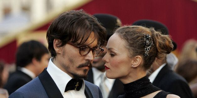 Johnny Depp shares a moment with his partner, French actress Vanessa Paradis, as they arrive atthe 77th Academy Awards Sunday, Feb. 27, 2005, in Los Angeles. Depp is nominated for an Oscar for best actor in a leading role for his work in