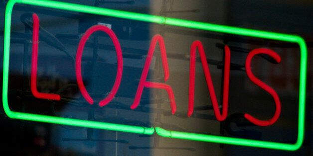 during economic crisis, this red and green neon LOANS sign in a retail window was one of many seen all...