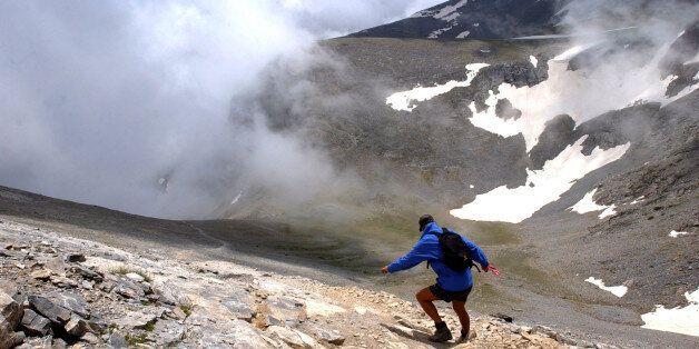 A German hiker walks down a slope of Mount Olympus, at 2,500 meters (8,200 feet) in northern Greece,...