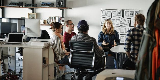Businesswoman leading project meeting with coworkers in high tech startup