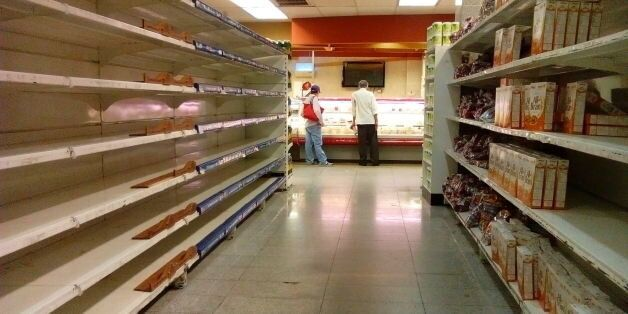 An empty supermarket is pictured in Caracas on May 28, 2016. The shortage of basic foodstuffs in Venezuela...