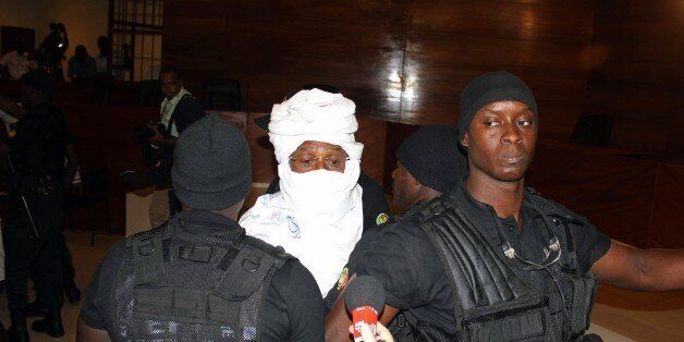 CORRECTS NAME OF PHOTOGRAPHER Security personnel surround former Chadian dictator Hissene Habre inside...
