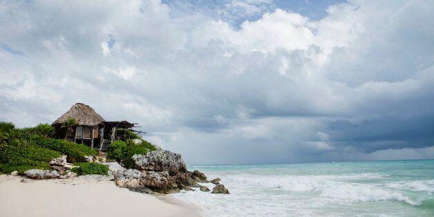 Eco beach bungalow on sandy beach on Caribbean