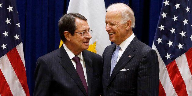 U.S. Vice President Joe Biden, right, meets with President Nicos Anastasiades of Cyprus on the sidelines...
