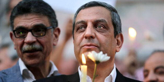 In this Tuesday, May 24, 2016 picture, Yahia Kalash, the head of journalists' union, holds a candle during...
