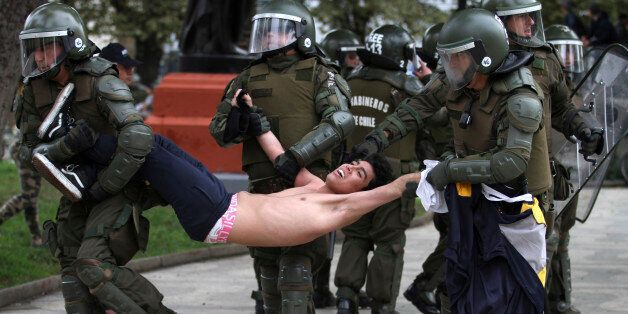 VALPARAISO, CHILE - MAY 26: A protester is detained by the police during a national demonstration organized...