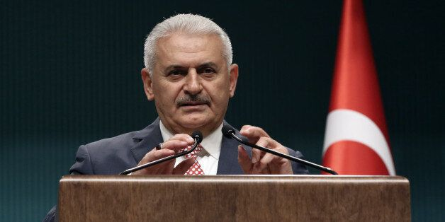 Binali Yildirim, who replaces the outgoing prime minister, Ahmet Davutoglu, announce his Cabinet after...
