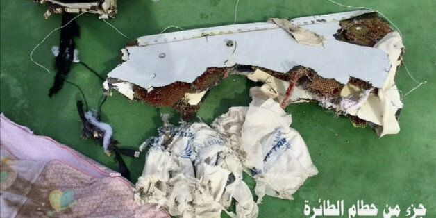 Recovered debris of the EgyptAir jet that crashed in the Mediterranean Sea is seen with the Arabic