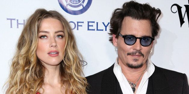 Amber Heard, left, and Johnny Depp arrive at The Art of Elysium's Ninth annual Heaven Gala at 3LABS on Saturday, Jan. 9, 2016, in Culver City, Calif. (Photo by Rich Fury/Invision/AP)