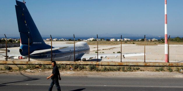 A man walks outside the old Athens' airport at Hellenikon suburb, southwest of Athens June 20, 2011....