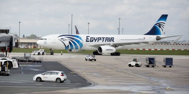An EgyptAir Airlines passenger jet is towed on the tarmac before departure from Charles de Gaulle airport,...