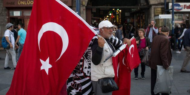 ISTANBUL, TURKEY - MAY 03: A man sells Turkish flags on the street outside the Eminonu Mosque on May...