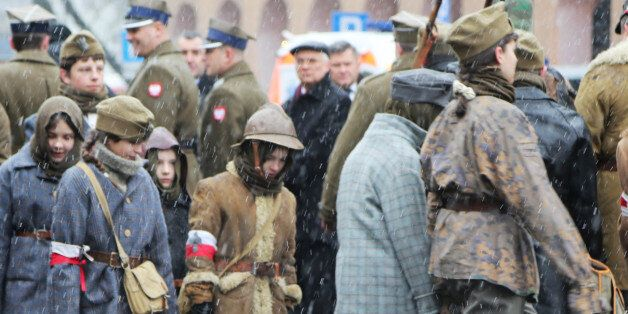 WARSAW, POLAND - 2016/03/01: Children dressed in different army style clothing from different era in...