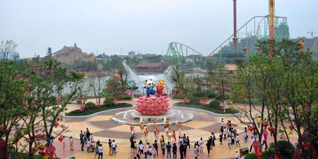 People visit the newly open theme park 'Wanda City' in Nanchang, east China's Jiangxi province on May...