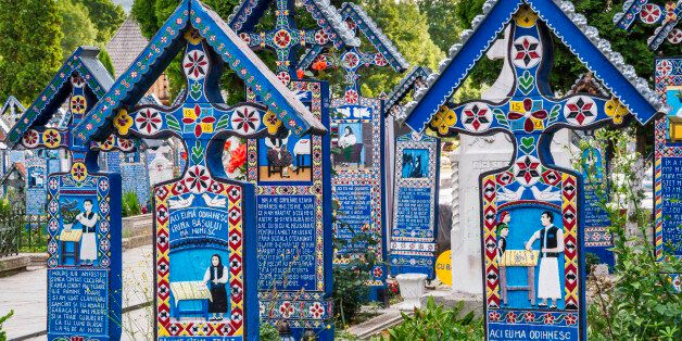 Carved wooden panels with epitaphs at crosses on graves, Merry Cemetery (Cimitirul Vesel) in Sapanta, Maramures Region, Romania.