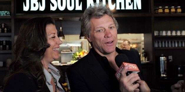 US signer Jon Bon Jovi and his wife Dorothea speak to the media after opening the BEAT (Bringing Everyone...