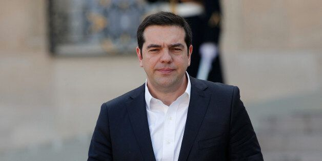 Greece's Prime Minister Alexis Tsipras leaves a meeting with European political leaders, at the Elysee...