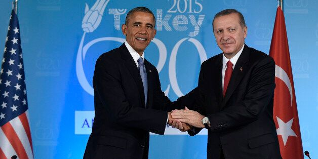 U.S President Barack Obama shakes hands with Turkey's President Recep Tayyip Erdogan in Antalya, Turkey,...