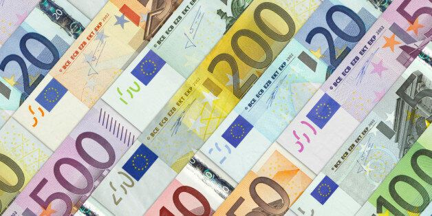 Euro banknotes photographed as a background. They have been placed in a row the one next to the other....