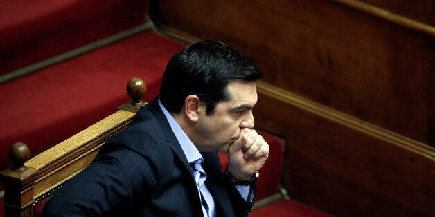 Greek Prime Minister Alexis Tsipras attends a parliamentary session before a vote of tax and pension...