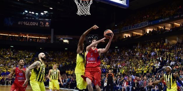 Moscow's Nando de Colo (C) goes up to score during the final basketball match CSKA Moscow vs Fenerbahce...