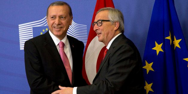 Turkish President Recep Tayyip Erdogan, left, is greeted by European Commission President Jean-Claude...