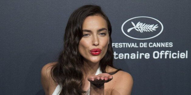 Model Irina Shayk poses during a photocall ahead of the Chopard Gold Party during the 68th Cannes Film...