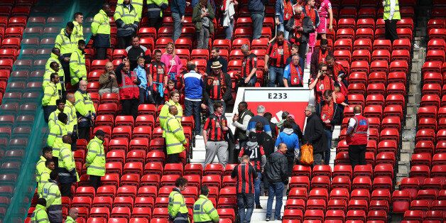 MANCHESTER, ENGLAND - MAY 15: Fans are evacuated from the ground as the match is abandoned ahead of the...