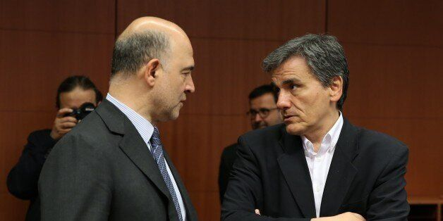 BRUSSELS, BELGIUM - MAY 9: Greek Finance Minister Euclid Tsakalotos (R) is seen during the Eurogroup...