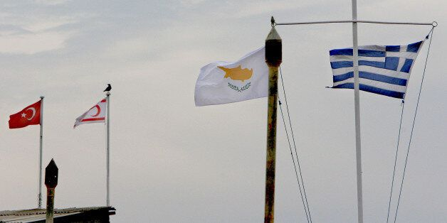 From the right to left, Greek, Cyprus, breakaway Turkish Cypriot state and Turkish flags seen in the...