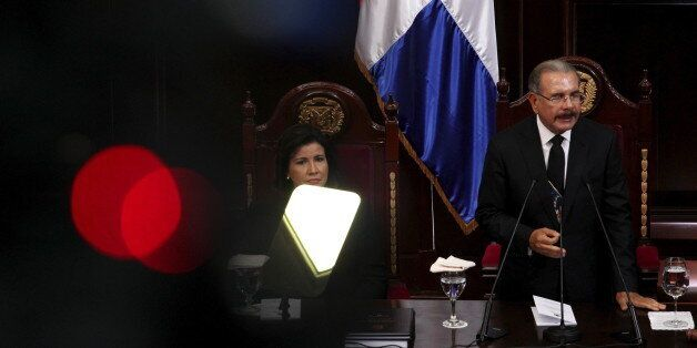 Dominican President Danilo Medina (R) and Vice President Margarita Cedeno (L) attend an Independence...