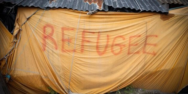 A makeshift tent with the word 'refugee' seen in the The Jungle Calais. June
