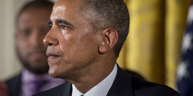 WASHINGTON, USA - JANUARY 5: U.S. President Barack Obama gets tearful as he delivers remarks in the East...