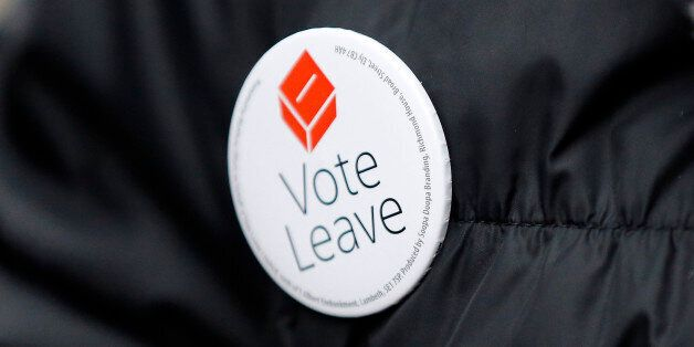 A Pro-Brexit campaigner hands out leaflets at Liverpool Street station in London, Wednesday, March 23,...
