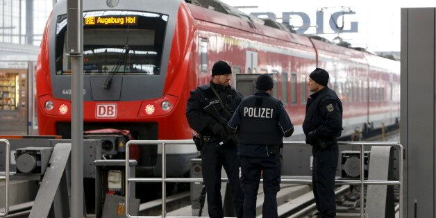 German police secure the main train station in Munich, Germany, January 1, 2016. REUTERS/Michaela Rehle...