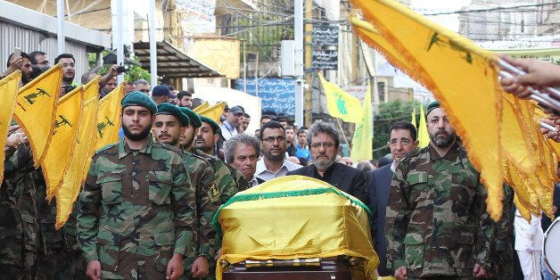 Adnan (C-L) and Hassan Badreddine (C-R), brothers of slain top Hezbollah commander Mustafa Badreddine...