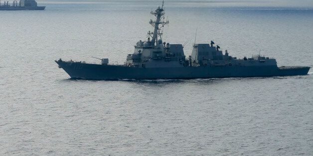 The USS William P. Lawrence guided missile destroyer, below, awaits refueling from a tanker, above, Wednesday,...