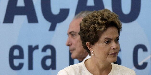 Brazil's President Dilma Rousseff (front) and Vice President Michel Temer arrive at a ceremony to announce...