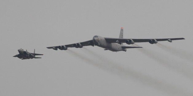 A U.S. Air Force B-52 bomber flies over Osan Air Base in Pyeongtaek, South Korea, Sunday, Jan. 10, 2016....