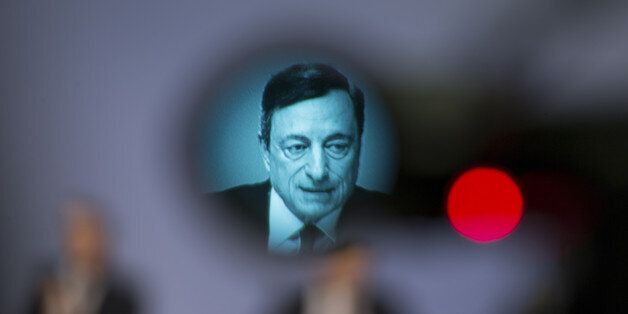 Mario Draghi, president of the European Central Bank (ECB), is displayed on a television camera viewfinder...