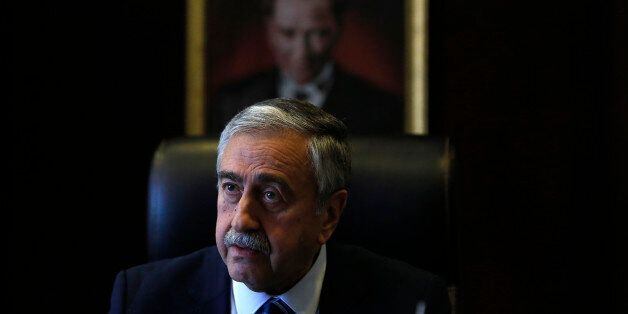 Turkish Cypriot leader Mustafa Akinci is seen at his office in front of the portrait of the Turkish Republic...