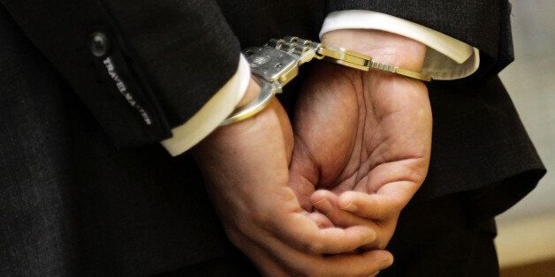 The handcuffed hands of Magnus Gaefgen are seen prior to the start of his trial against the state of...