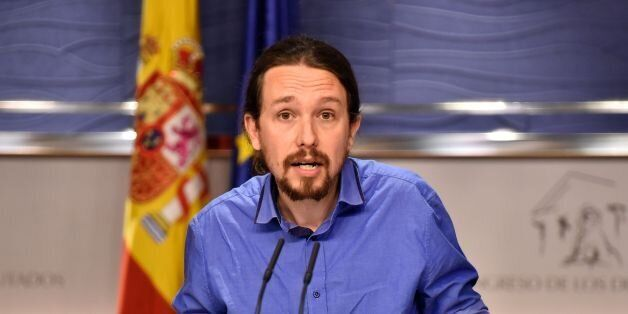 Leader of left wing party Podemos Pablo Iglesias gestures during a press conference at the Spanish parliament...