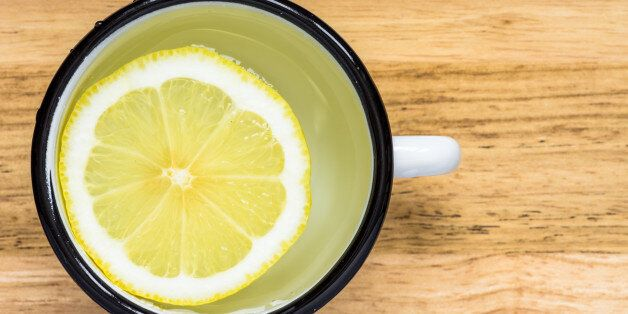 Water with lemon in a steel mug top view
