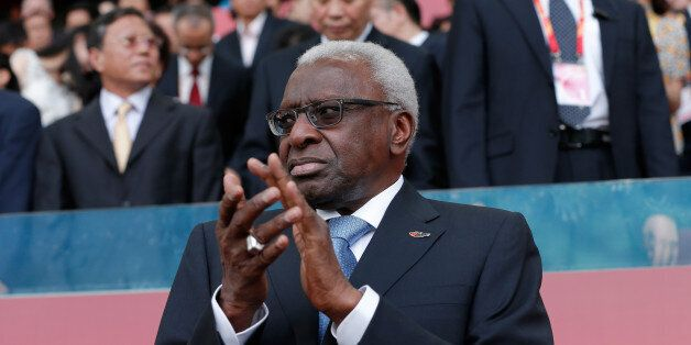 BEIJING, CHINA - AUGUST 22: Outgoing president of the IAAF Lamine Diack applauds during day one of the...