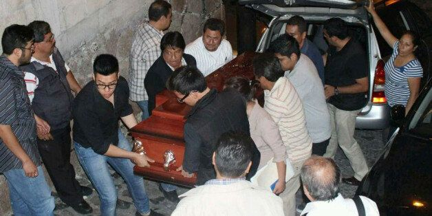 Family and friends bear the coffin of journalist Francisco Pacheco Beltran on April 25, 2016 in Taxco...