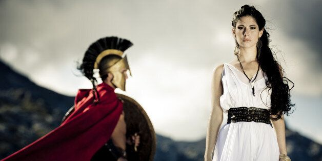 Portrait of spartan queen and spartan warrior with selfmade theater clothings,selective focus on her,...
